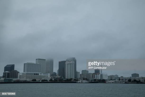 Storm clouds hang over downtown New Orleans as Hurricane Nate moves into Souther Louisiana on October 7 2017 Residents in three states along the US...