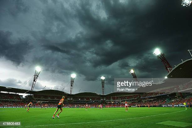 Storm clouds hang over the stadium during the round one AFL match between the Greater Western Sydney Giants and the Sydney Swans at Spotless Stadium...