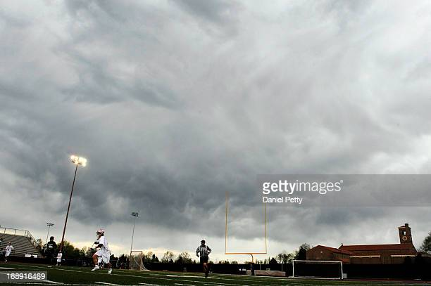 Storm clouds hover over a CHSAA 5A boys lacrosse semifinal game between Regis Jesuit High School and Arapahoe at All City Stadium on May 15 in Denver...