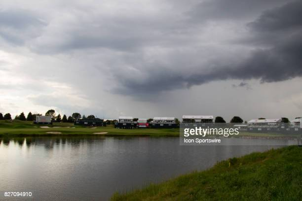 Storm clouds loom over the 18th hole as the course is evacuated for severe weather during the Final Round of the 3M Championship on August 6 2017 at...