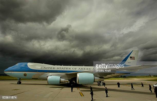 Storm clouds loom overhead as Air Force One and US President George W Bush arrive in Paris Bush has arrived to meet French President Jacques Chirac...