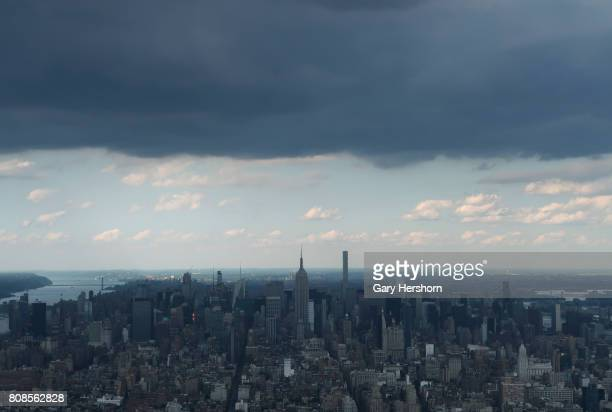 Storm clouds move across Manhattan above the Empire State Building in New York City on July 3 2017