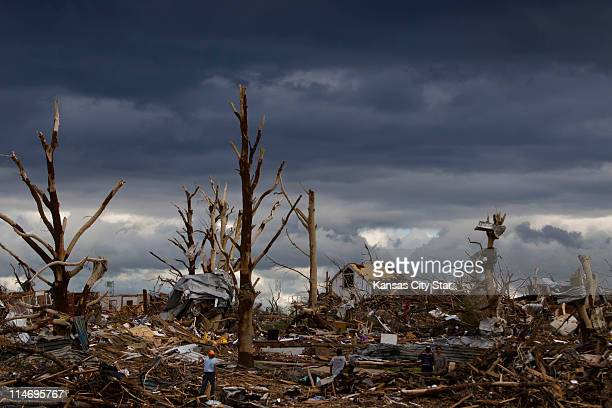 Storm clouds move over Jopin, Missouri, on Wednesday, May 25 following the devastation caused by a tornado that swept through the city's central...