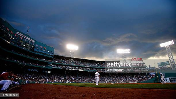 Storm clouds move over the field during a game between the Boston Red Soxb and the Tampa Bay Rays at Fenway Park on July 29 2013 in Boston...