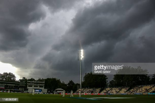 Storm clouds move over the ground on day one of the second cricket Test match between England and New Zealand at Seddon Park in Hamilton on November...