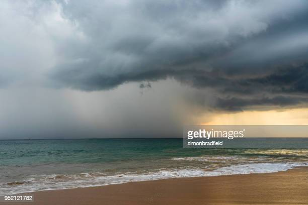 storm clouds of sri lanka - heavy rain stock photos and pictures