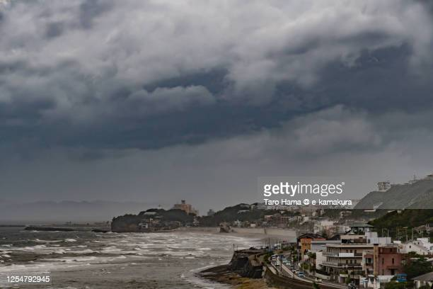 storm clouds on the beach in kanagawa prefecture of japan - taro hama ストックフォトと画像