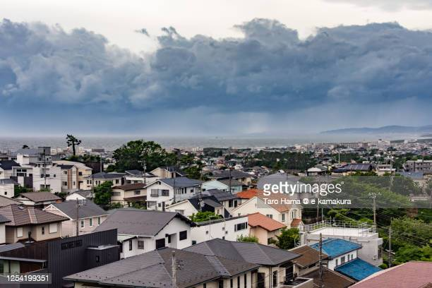storm clouds on the residential district by the beach in kanagawa prefecture of japan - 平塚市 ストックフォトと画像