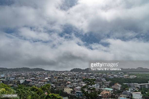 storm clouds on the residential district in kanagawa prefecture of japan - taro hama ストックフォトと画像