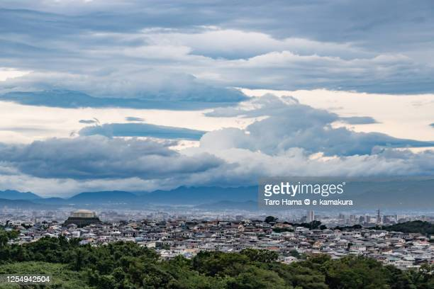 storm clouds on the residential district in kanagawa prefecture of japan - chigasaki stock pictures, royalty-free photos & images