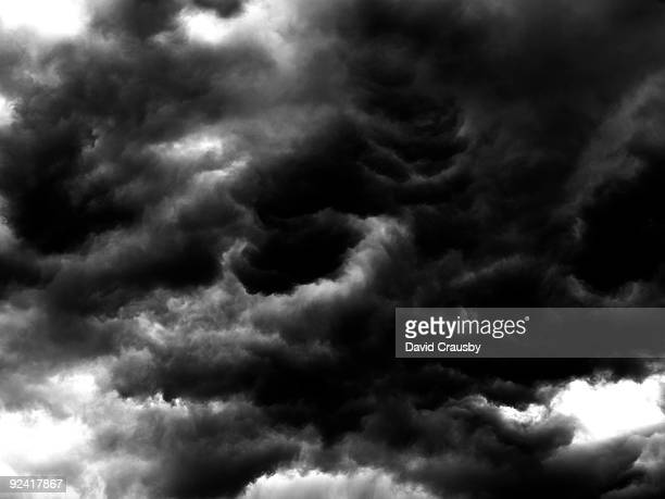storm clouds over a northern town - crausby stock pictures, royalty-free photos & images