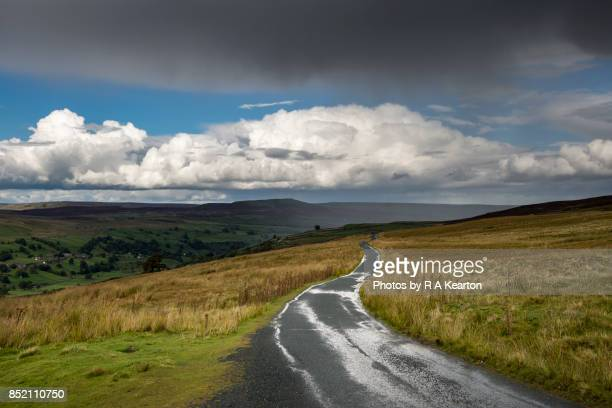Storm clouds over a remote moorland road, North Yorkshire