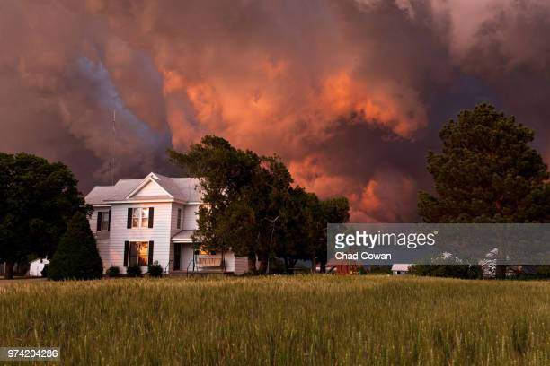 storm clouds over house, kansas, usa - ominous stock photos and pictures