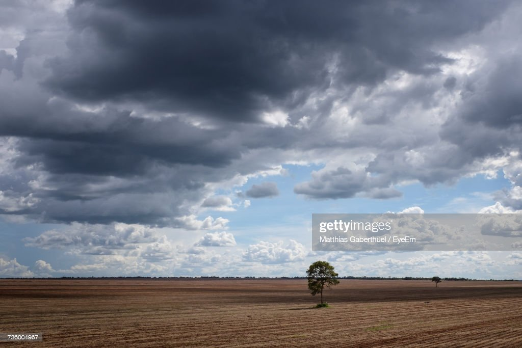 Storm Clouds Over Landscape Against Cloudy Sky : Stock-Foto