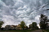 dark thunderstorm clouds over small midwest