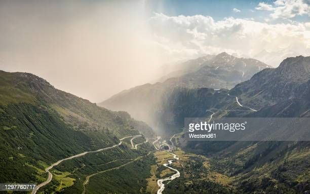 storm clouds over mountain and valley with river - valais canton stock pictures, royalty-free photos & images