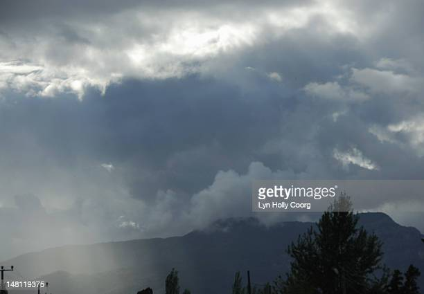 storm clouds over mountains and trees - lyn holly coorg stock photos and pictures