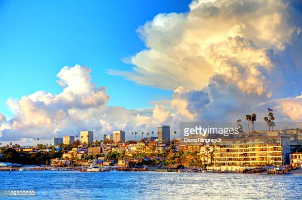 storm clouds over newport beach, california - costa mesa stock photos and pictures