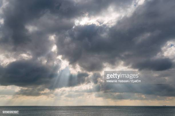 storm clouds over sea - ominous stock photos and pictures
