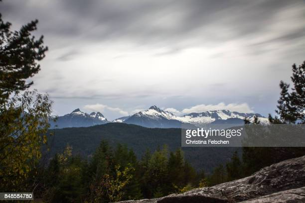 storm clouds over squamish, british columbia - christina felschen stock pictures, royalty-free photos & images