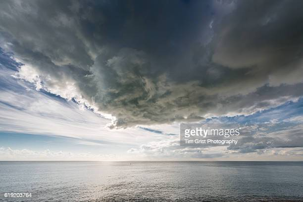 storm clouds over the english channel - english channel stock photos and pictures