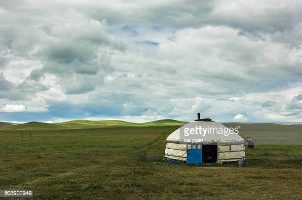 storm clouds over the mongolian yurt(ger) on hulunbuir grasslands,hulun buir city,inner mongolia,china - yurt stock pictures, royalty-free photos & images