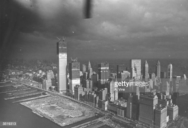 Storm clouds over the New York skyline where the World Trade Center is under construction