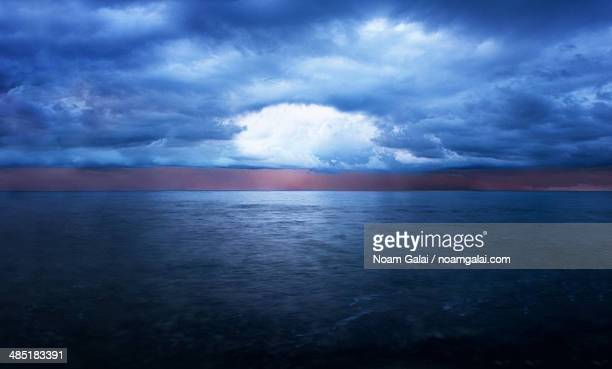 storm clouds over the ocean - noam galai stock pictures, royalty-free photos & images