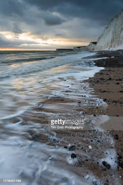 storm clouds over the seven sisters cliffs, uk - seascape stock pictures, royalty-free photos & images