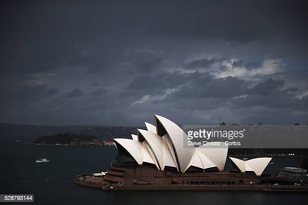 Storm clouds over the Sydney Opera House and Harbour Bridge Sydney Australia Thursday 3rd October 2013