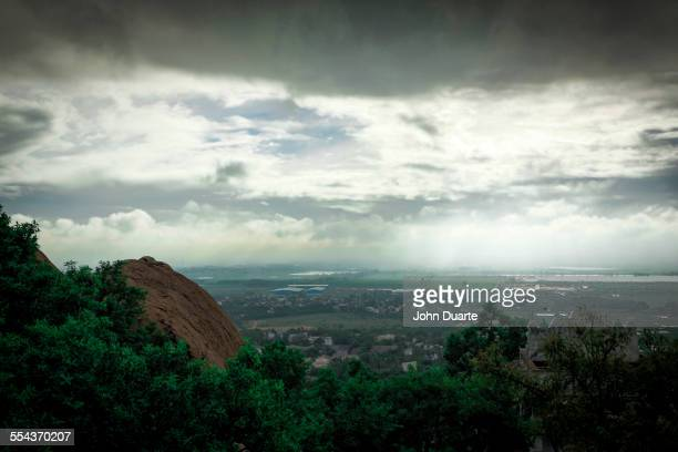 Storm clouds over treetops in rural landscape