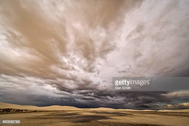 storm clouds over white sands - don smith ストックフォトと画像