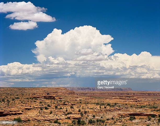 storm clouds overhead in the desert - yeowell stock pictures, royalty-free photos & images