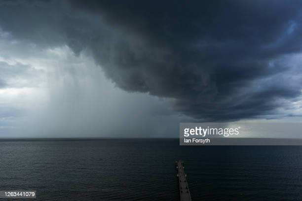 Storm clouds pass over Saltburn pier on August 02 2020 in Saltburn By The Sea England Heavy showers have continued through much of the day but will...
