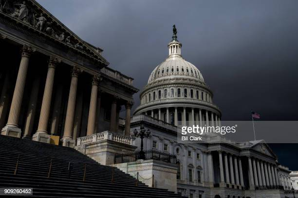 Storm clouds pass over the dome of the US Capitol building on Tuesday Jan 23 2018