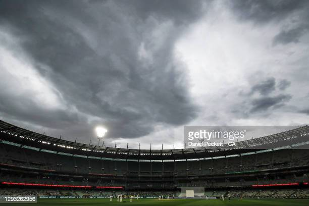 Storm clouds roll in over the MCG towards the end of day two of the Second Test match between Australia and India at Melbourne Cricket Ground on...