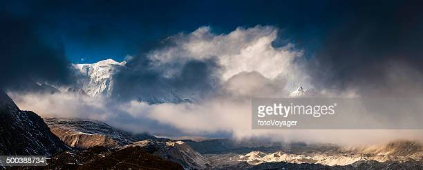 storm clouds sunlight on ngozumpa glacier cho oyo himalayas nepal - rock formation stock photos and pictures