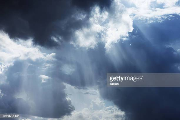 Storm cloudscape with sunbeams on a dramatic sky