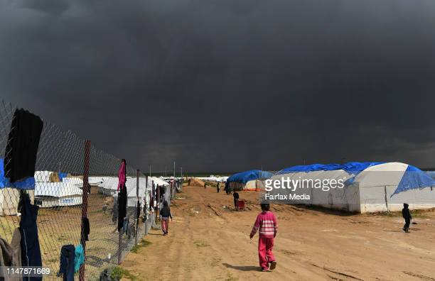 Storm clowds gather over the alHawl refugee camp in northern Syria close to the SyriaIraq border April 2 2019 The camp is home to around 72000 people...