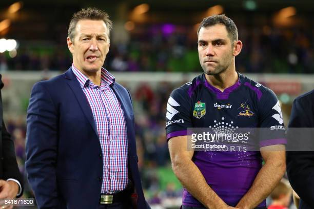 Storm coach Craig Bellamy and Cameron Smith of the Storm look on after the round 26 NRL match between the Melbourne Storm and the Canberra Raiders at...