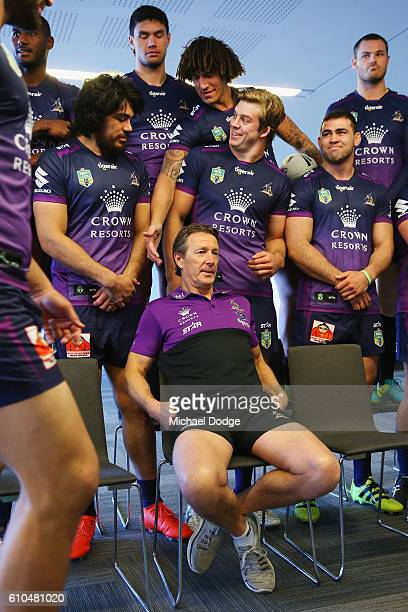 Storm coach Craig Bellamy and players wait for the team photograph to take place during a Melbourne Storm NRL media opportunity at AAMI Park on...