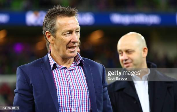 Storm coach Craig Bellamy and Todd Greenberg Chief Executive Officer of the National Rugby League look on after the round 26 NRL match between the...