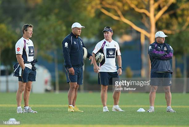 Storm coach Craig Bellamy Assistant Coach David Kidwell Development Coach Adam O'Brien and Assistant Coach Kevin Walters look on during a Melbourne...