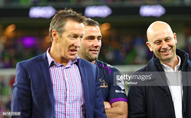 Storm coach Craig Bellamy Cameron Smith of the Storm and Todd Greenberg Chief Executive Officer of the National Rugby League look on after the round...