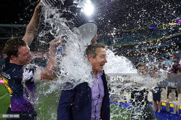 Storm coach Craig Bellamy is drenched with water after winning the 2017 NRL Grand Final match between the Melbourne Storm and the North Queensland...