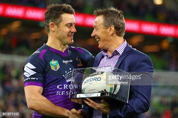 Storm coach Craig Bellamy presents Cooper Cronk of the Storm with the match ball after Cronk played his final home match after the round 26 NRL match...