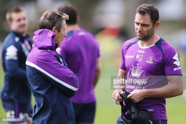 Storm coach Craig Bellamy talks with Cameron Smith during a Melbourne Storm NRL training session at AAMI Park on September 18 2017 in Melbourne...