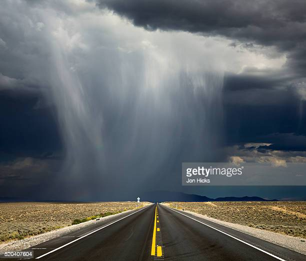 a storm crosses highway 50, 'america's loneliest road'. - nevada stock pictures, royalty-free photos & images