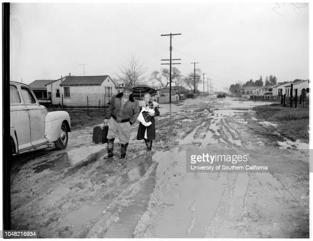 Storm damage, 07 March 1952. County Road Department Scraper at work, etc;Gene Barry;Rio Hondo River running full, etc;Firestone Boulevard Flooded,...