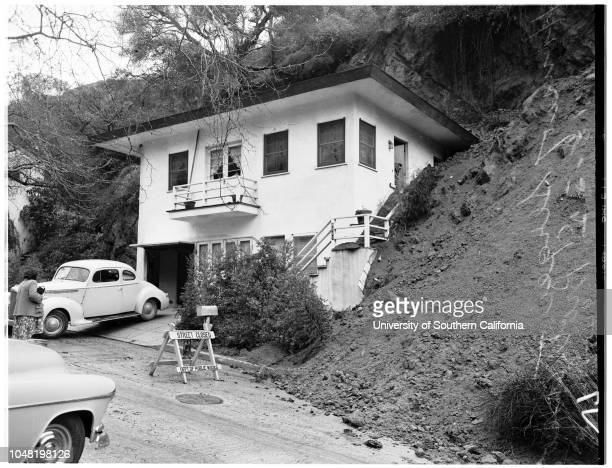 Storm damage at Laurel Canyon Boulevard, 18 January 1952. Sergei Protzenko, and wife, Carla Bryan, move belongings out of their house at 8057 Laurel...